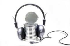 Tin can with headphones Royalty Free Stock Image