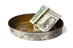 Tin can with money Stock Photo