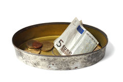 Tin can with money Royalty Free Stock Photos