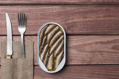 Free Tin Can Of Sprats Fish, Sardines With Knife And Fork On Wooden Table. Top View And Free Space Royalty Free Stock Photography - 96772907