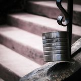 A tin can with out of focus stairs leading up to the can stock photos