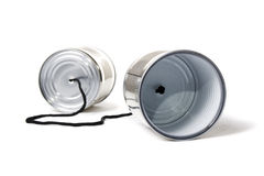 Tin can phone. On white background Stock Photo