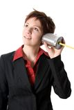Tin can phone. Woman in a suit listening to a tin can phone Royalty Free Stock Photos