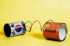 Tin can phone with China and South Korea Flag .communication concept stock photography