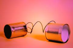 Tin can phone. Communication concept Stock Photo