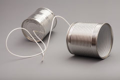 Tin can phone.communication concept Stock Photo