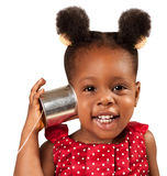 Tin can phone concept. Little African American girl listening with tin can phone while  smiling Royalty Free Stock Photos