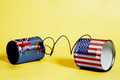 Tin can phone with USA and Fiji Flag.communication concept Stock Photography