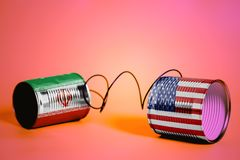 Tin can phone with USA and Iran Flags.communication concept stock photography