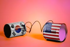 Tin can phone with USA and South Korea Flags.communication concept stock photos