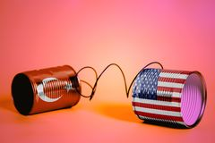 Tin can phone with USA and Turkish Flags.communication concept royalty free stock image