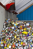 Tin Can Recycling. A pile of old tin cans at a recycling depot waiting to be processed Stock Photos
