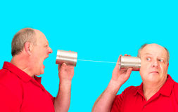 Tin Can String Telecommunications. A man demonstrating his poor cell phone communication reception lol Stock Image