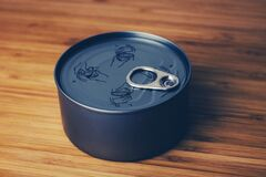 Tin can on table Royalty Free Stock Photography