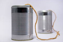 Tin can telephone. A telephone made from tin cans Royalty Free Stock Photo