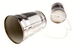 Tin can telephone. On white Royalty Free Stock Images