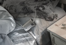 Tin can telephone on bed Stock Image