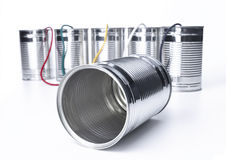 Tin Can Telephone. Exchange on a white background Royalty Free Stock Images