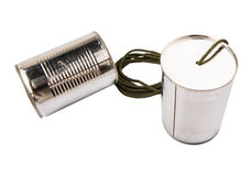 Tin Can Telephone I. Tin can telephone over white background Royalty Free Stock Images