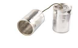 Tin Can Telephone VI. Tin can telephone over white background Royalty Free Stock Photo