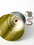 Tin Can Telephone. On a white background Stock Photo