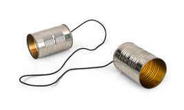 Tin can telephones. Tin cans connected by string on white background Stock Images