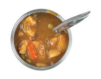 Tin can of vegetable stew with spoon inserted Stock Photo