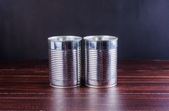 Tin can on wooden table background Royalty Free Stock Images