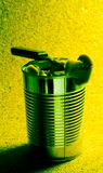 Tin can on yellow background royalty free stock photography