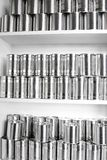 Tin cans. Plain tin cans on shelf Royalty Free Stock Images