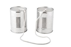 Tin cans connected by string. Closeup of tin cans telephone connected by string on white background, business communication concept Royalty Free Stock Photography