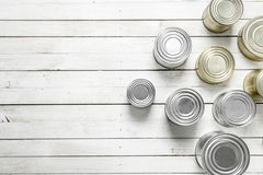 Tin cans with food. On white wooden table Stock Photography