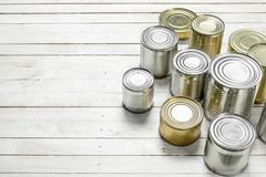 Tin cans with food. On white wooden table Stock Photo