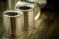 Tin cans for food on wooden background. Selective focus and color effect Royalty Free Stock Photos