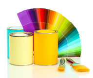 Tin cans with paint, brushes and bright palette. Of colors over the white Stock Photo