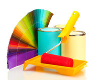 Tin cans with paint, roller, brushes. And bright palette of colors over the white Stock Image