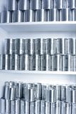 Tin cans. Stacked on shelves Royalty Free Stock Photos