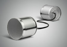 Tin cans telephone with cord on grey, telephony concept Stock Photos