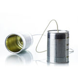 Tin cans telephone. On white background Royalty Free Stock Image