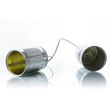 Tin cans telephone. On white background Royalty Free Stock Photography