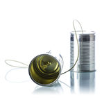 Tin cans telephone. On white background Stock Images