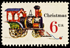 Tin and Cast Iron Locomotive Christmas Stamp Stock Image