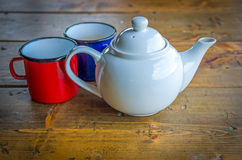 Tin coffee mugs and teapot Stock Photo