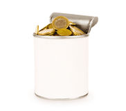 Tin with coins on Royalty Free Stock Photos