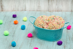 Tin of Colorful Confetti Cookies With Decorative Balls Stock Images