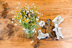 Tin Cookie Cutters and Flowers Sitting on Wooden Table Stock Image