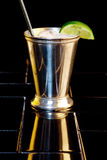 Tin cup with chilled drink. Chilled drink laced with lemon stock images