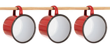 Tin Cups. Hanging on Stick on White Background Stock Image