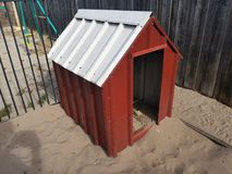 Doghouse. Tin doghouse sand Royalty Free Stock Photography