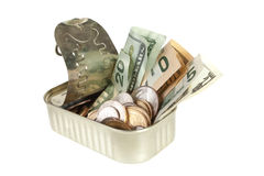 Tin of dollars Stock Photography